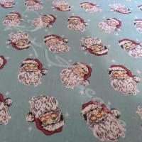 Jolly Santa Faces on Blue Polycotton Print