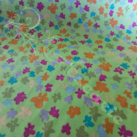 Multi Coloured bows on Green 100% Cotton